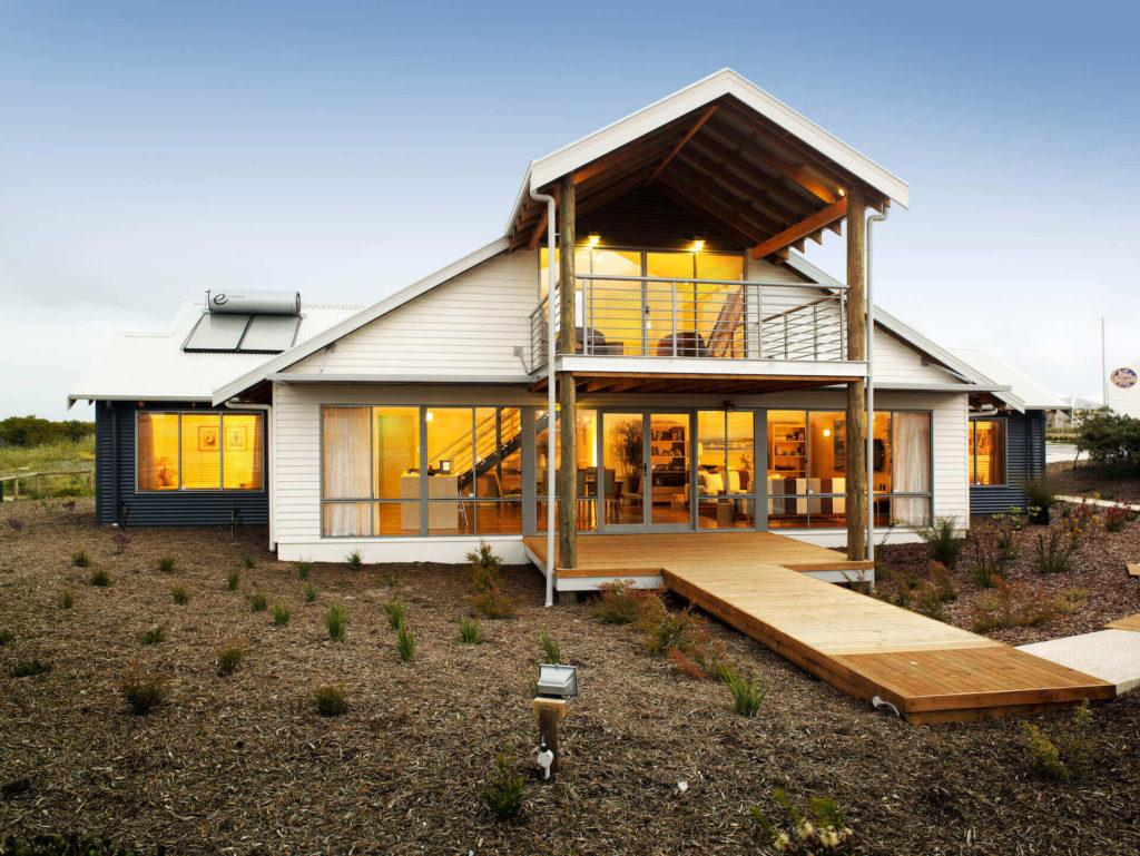 Front view of Capricorn Loft at sundown with house lights on - RuralBuilding Co.