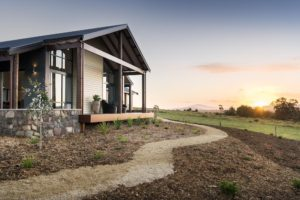 Rural Building Co - Newly built home in open countryside against sunset
