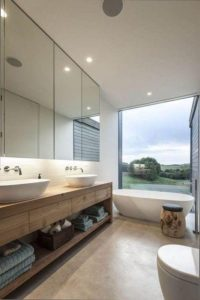 Rural Building Co - Modern bathroom with country view and down lights