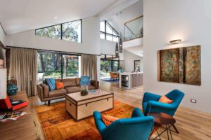 Rural Building Co - Blue and orange living room