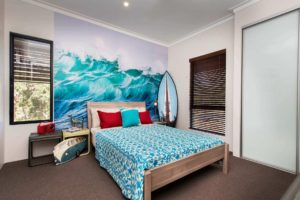 Rural Building Co - The Quedjinup - bedroom with ocean wall paper against wall