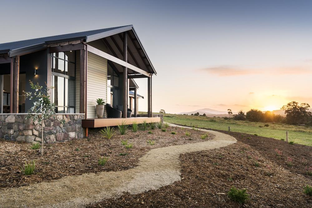 Rural Building Co - Newly built home against sunset