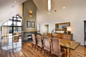 Rural Building Co - Open-plan dining room with fireplace